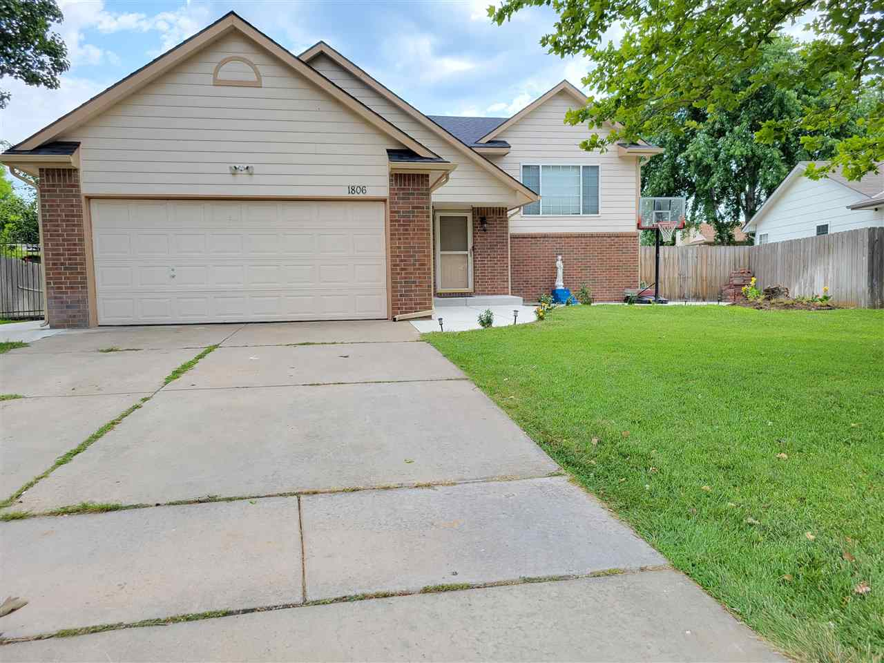 Great bi-level home features 5 bedrooms, 3 bath, 2 car garage, huge sunroom & family/rec room, fully fenced-in yard. New concrete poured around the house,  flooring , interior, and exterior paint.  Lots of fruit trees.