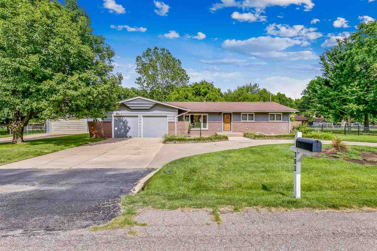 This amazing one-level, spacious home includes incredible family living space, 4-car garage, and a c