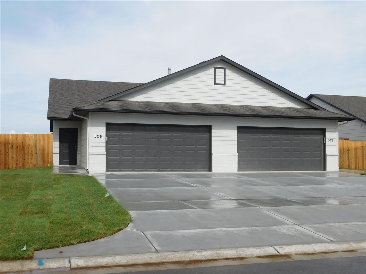 New 3 bed, 2 bath 2 car garage with White cabinetry and granite in kitchen and bath.  Luxury vinyl f
