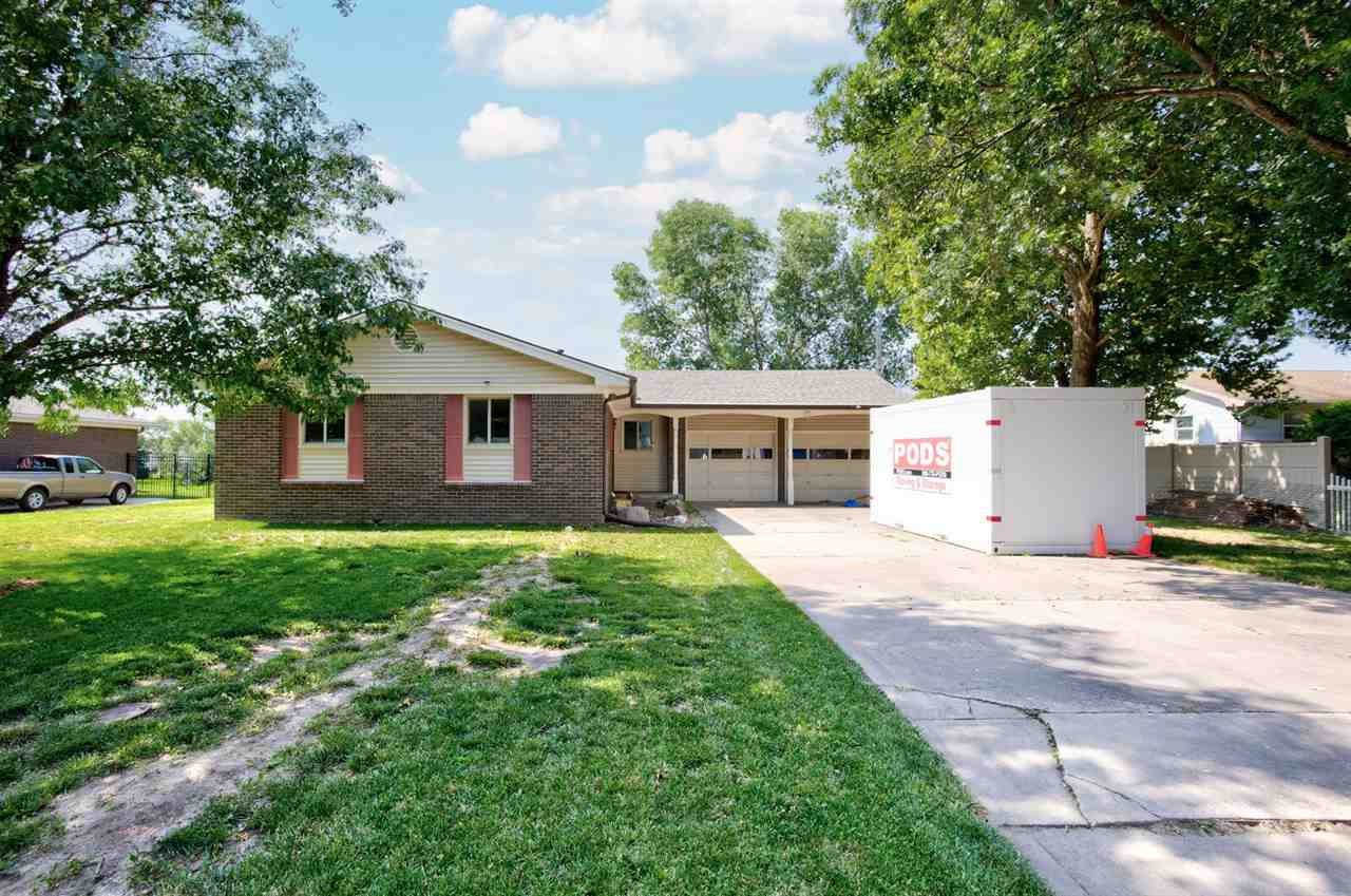 The home is nestled in a neighborhood subdivision that has well established trees and the homes all