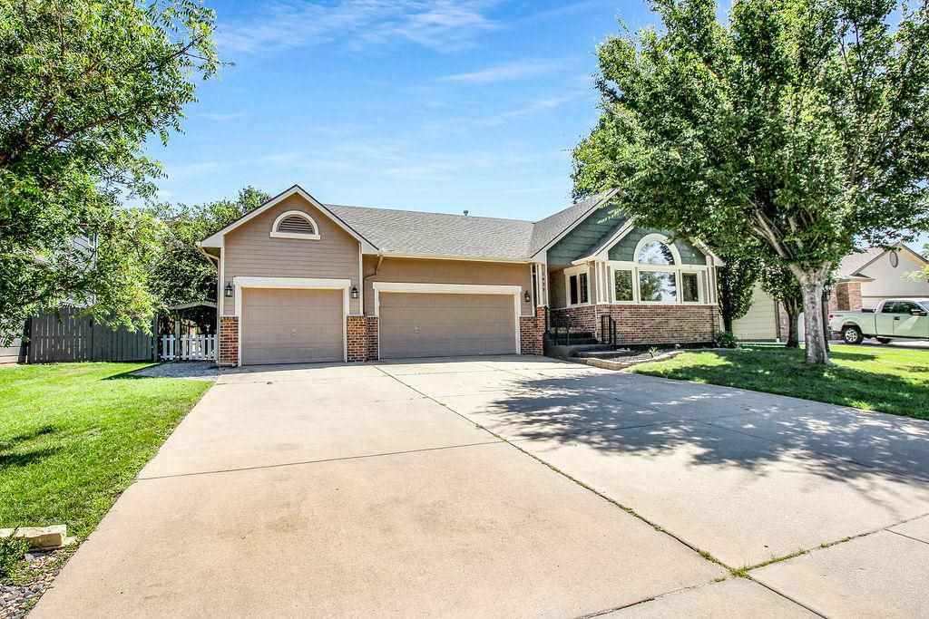 This beautiful home in Broadmoor Hills features an open floor plan with vaulted ceilings.  You will
