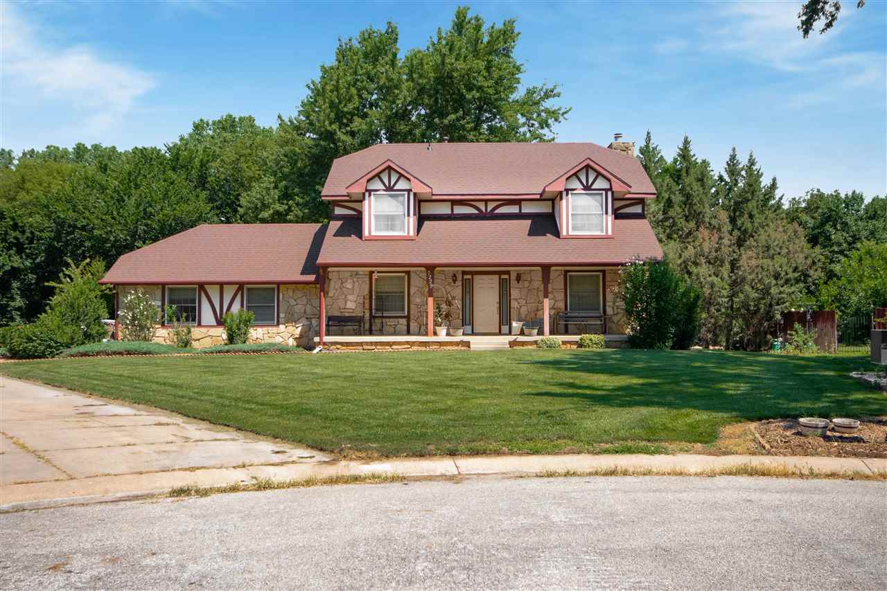 Well maintained home on a quiet cul-de-sac on nearly 1 full acre lot in this established Derby neigh