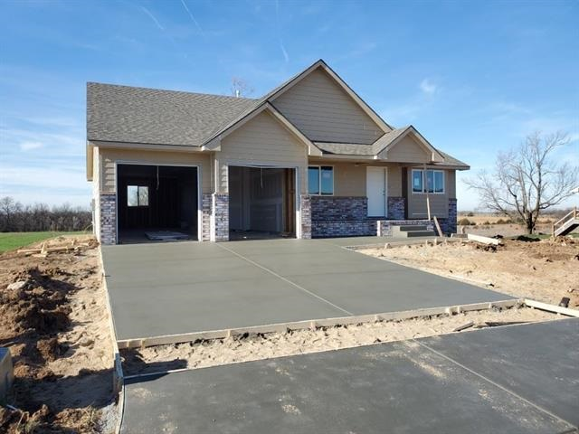 New home will be ready for new owner by the end of October. Some selections can still be made. Amenities will include covered deck, granite counter tops, tiled master shower and oversized 3 car garage with depth of approx. 44 feet deep. Finished basement will include 2 bedrooms, 1 bath, rec room and wet bar.