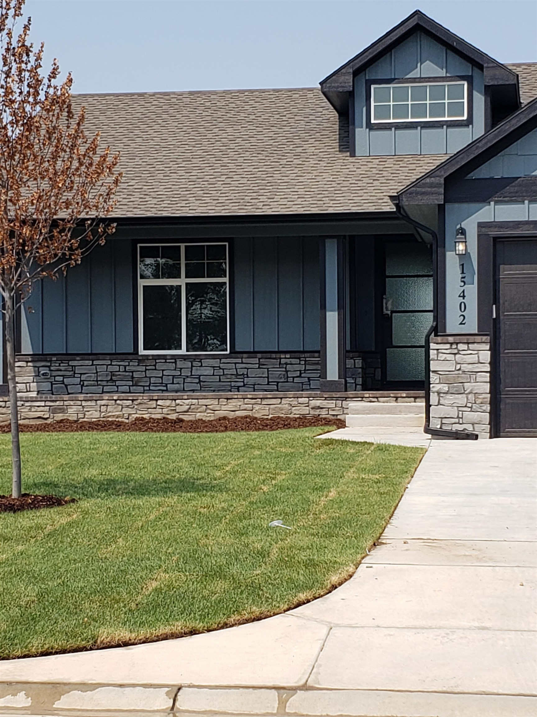 NEW construction Ranch has an open floor plan with hugh windows, big kitchen island, hidden walk-in pantry, quartz/granite counters, and every bedroom has a walk-in closet! The master bedroom has special wall treatment and the master bath has a door-less walk-in shower. This home has an upgraded energy package, like a tank less water heater, to lower your monthly bills. Finished walk-out walk-up basement has a big family room, wet bar, 2nd walk-in pantry and space for a full size frig! Home is set in a secluded area backing up to water, with a neighborhood saltwater pool, 3 lakes, great fishing, nature trails to enjoy, but has low, 1.16 mil levy Sedgwick Co Taxes! Wichita Schools. Price includes 100 ft well, sprinklers, sod & 2 trees and fully finished basement. Completion date is soon! Welcome Home!