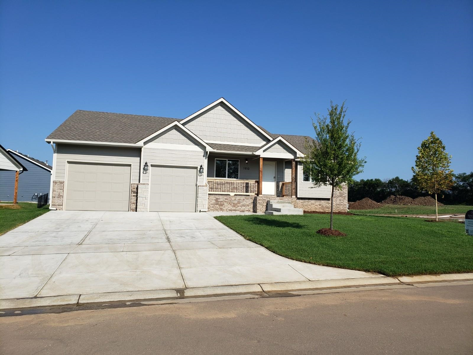 Beautiful new walk-out walk-up ranch in Whispering Lakes, backs up to water with a tandem 3 1/2 garage that could fit a boat and trailer, or room for a shop. Granite or quartz on all counter tops, open floor plan, hidden walk-in pantry, basement wet bar, and a covered deck over the walk-out patio. Master bath has a shower room with 2 shower walls and a full wall of storage! Low traffic in a quiet and secluded neighborhood with saltwater pool, nature tails, three lakes to enjoy, great fishing, and close to HWY 96 or Andover Dillon's Marketplace and YMCA. Wichita Schools. Will be completed in November.