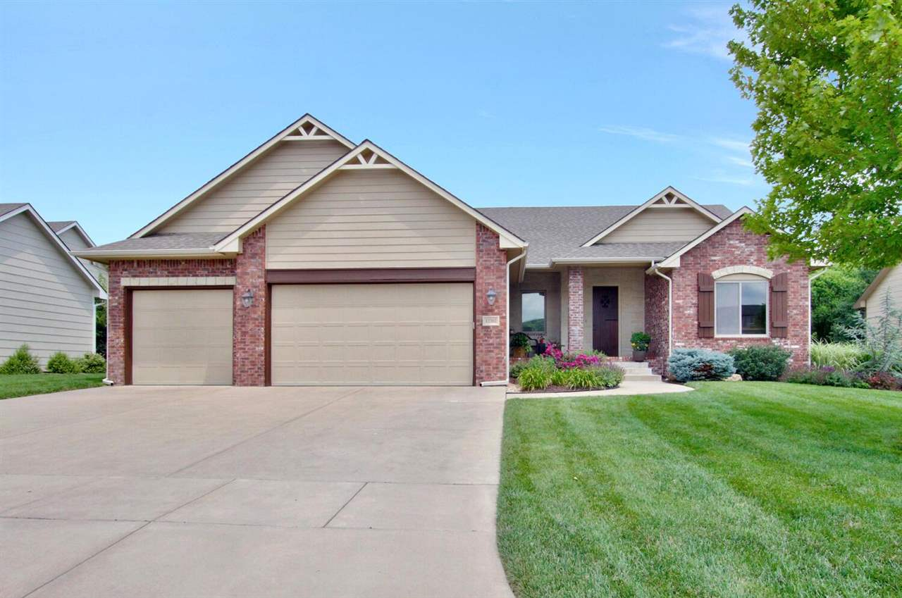 Beautiful 5 BR 3 BA house in well desired Crestlake subdivision in Andover School District.  Quiet neighborhood close to K96 and Kansas Turnpike.  As you enter the home you are greeted to a large open floor plan with a stone gas fireplace, boxed beamed 10' ceiling and beautiful hardwood floors.  The gorgeous kitchen has everything you are looking for:  a center island, granite countertops, large walk-in pantry, and stainless appliances.  Adjacent from the kitchen is the dining area with easy access to the covered deck.  The master bath has his and her vanities, a soaker tub, and a tile shower.  The master walk-in closet has direct access to the laundry room.  The full, finished , view out basement includes another stone fireplace, wet bar and plenty of room for entertaining, game tables, etc.  Two more bedrooms and a full guest bath complete this lower level.  Home has a sprinkler system and beautiful landscaping.  Located in the award winning Andover School District but with Wichita taxes.