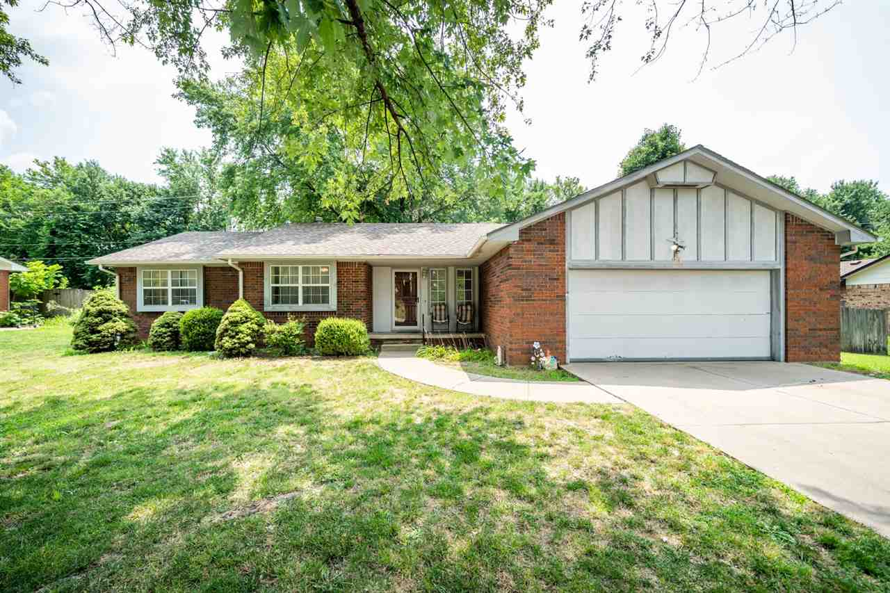 A welcoming neighborhood with mature trees & large lots brings you home to this full brick ranch.  W