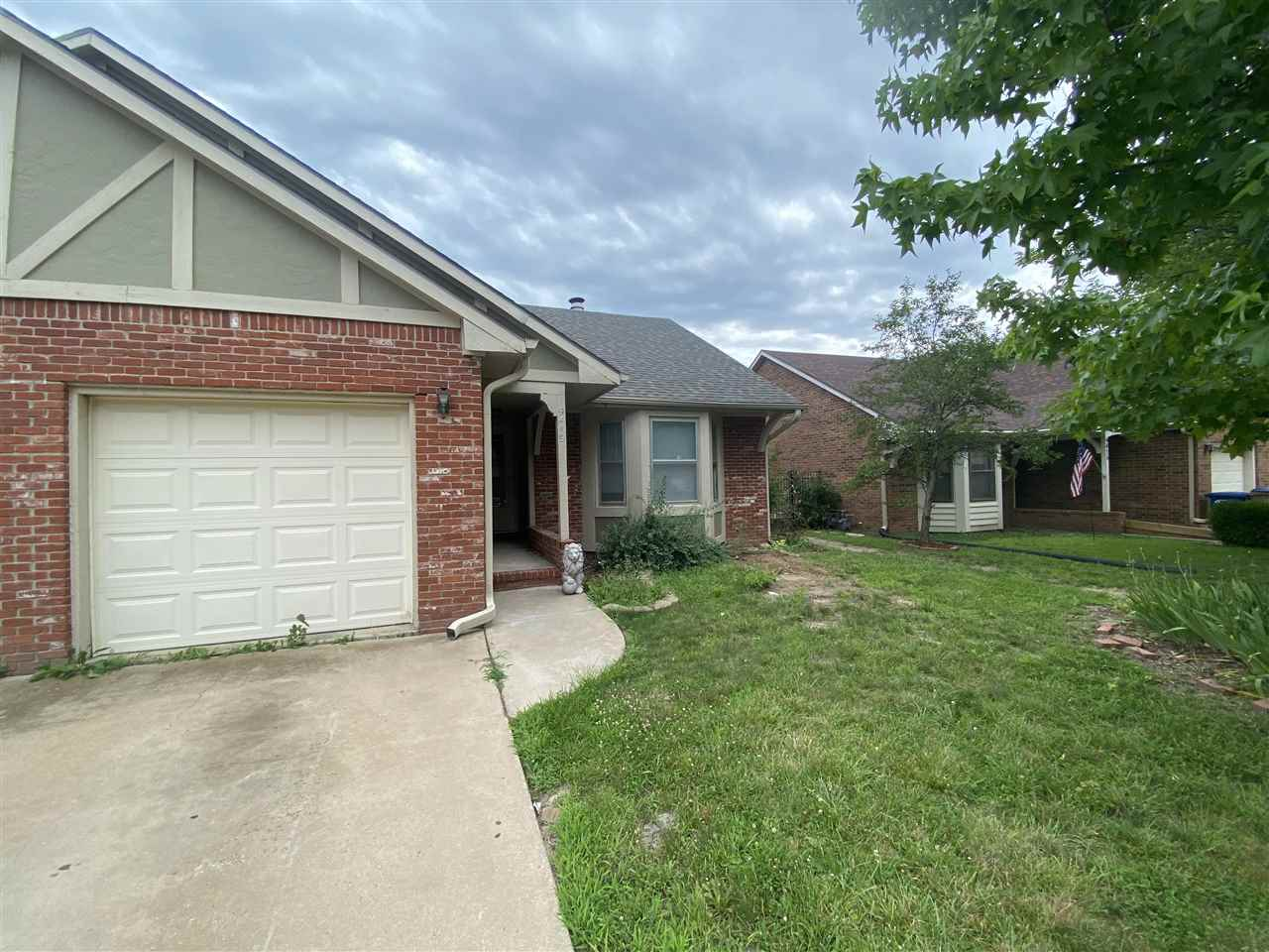 Freshly painted 3 bed 2 bath townhome in East Wichita.  Huge living area with vaulted ceiling on mai