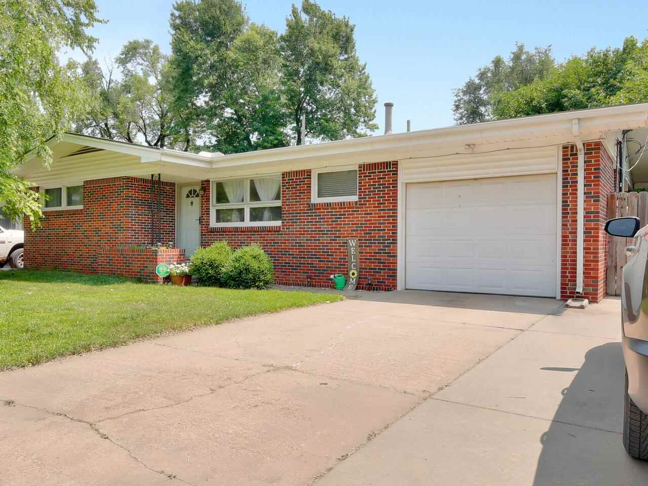 Adorable brick home in the Riverlawn Hieights Addition. The home has been tastefully updated with ne