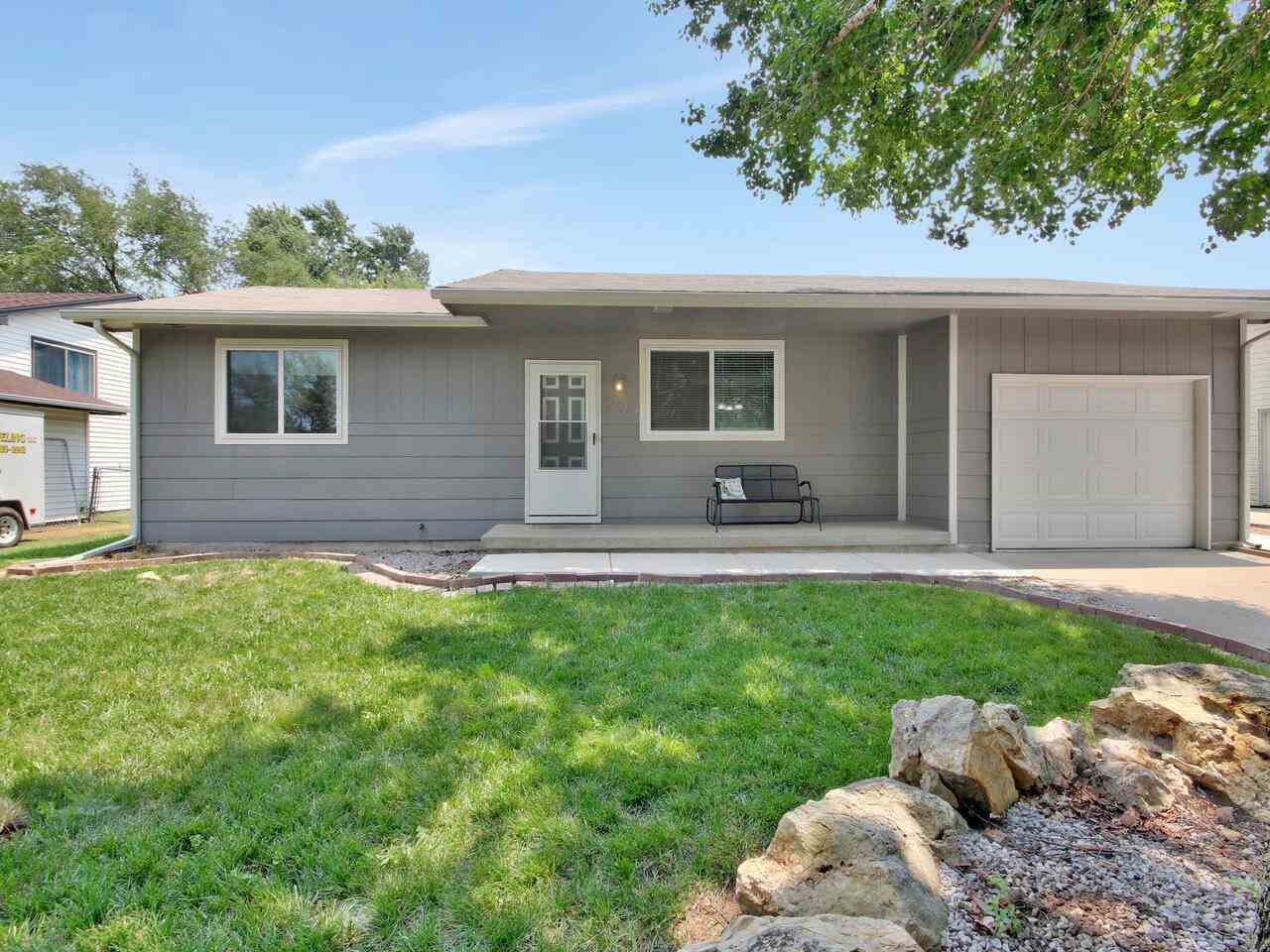 This 2 bed/1 bath home is UPDATED and MOVE IN READY.  The Living Room has a new electric fireplace w