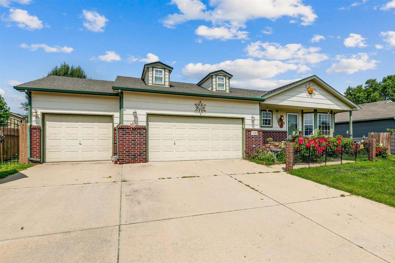 4 bed/3 full bath ranch in Goddard School District! Additional finished room in the basement with an
