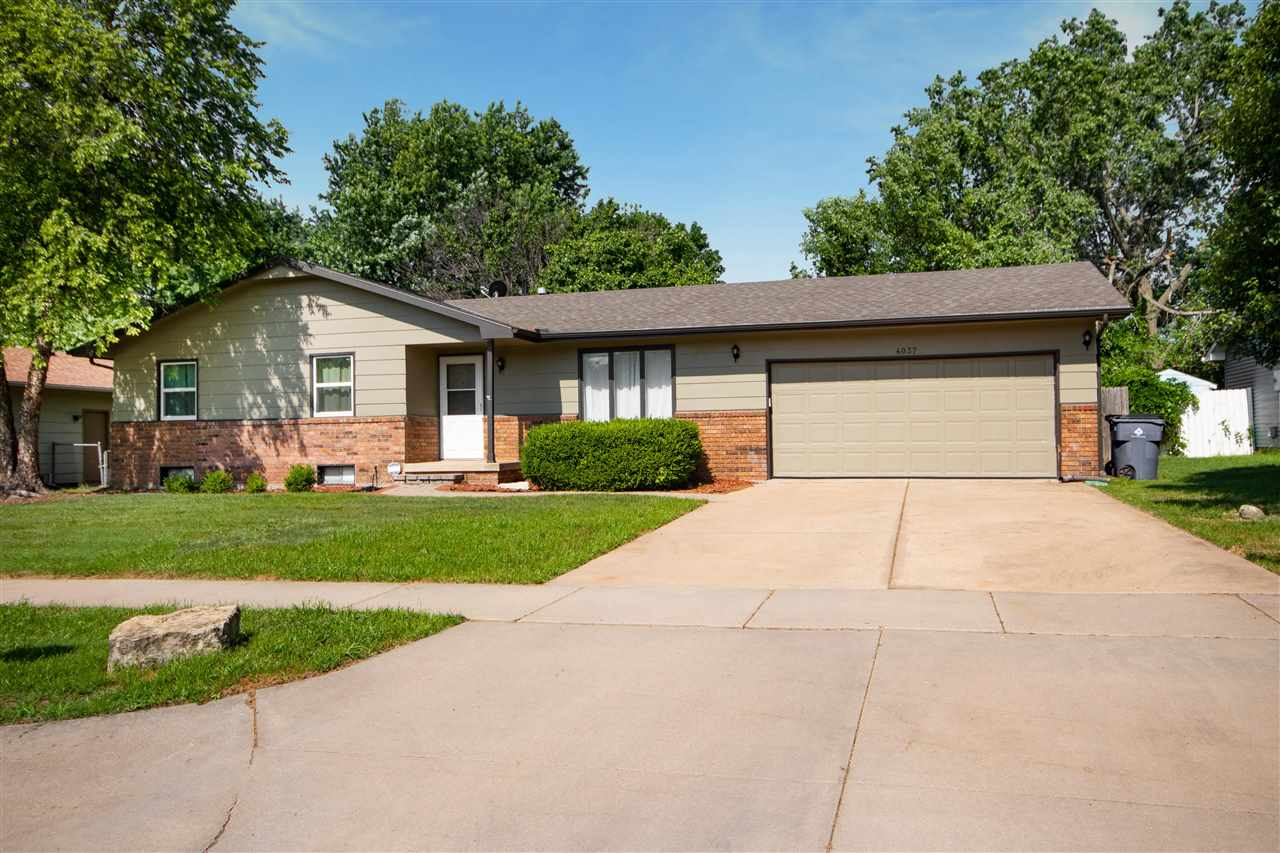 Come see this ranch style home in Bel Aire! Great curb appeal and mature trees on this lot with a wi