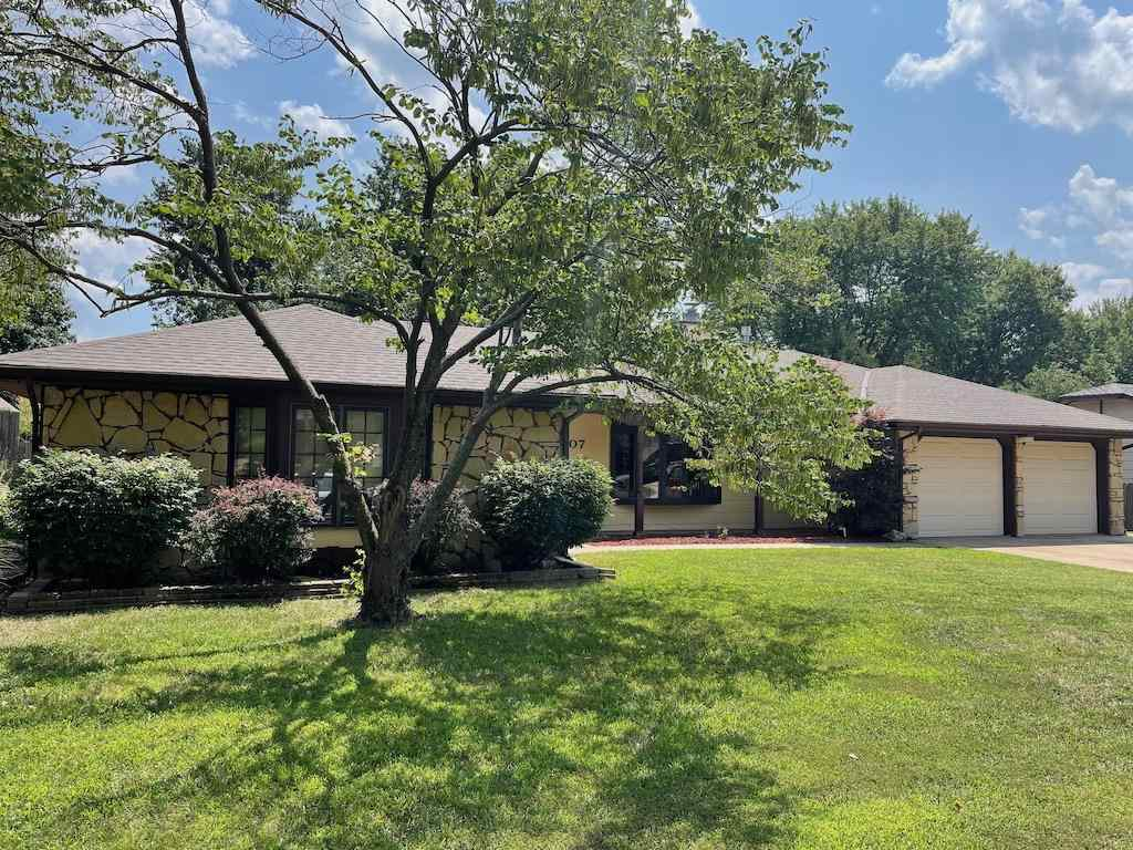 Huge sprawling ranch in the heart of Derby. Large lot with mature trees and more space inside the ho