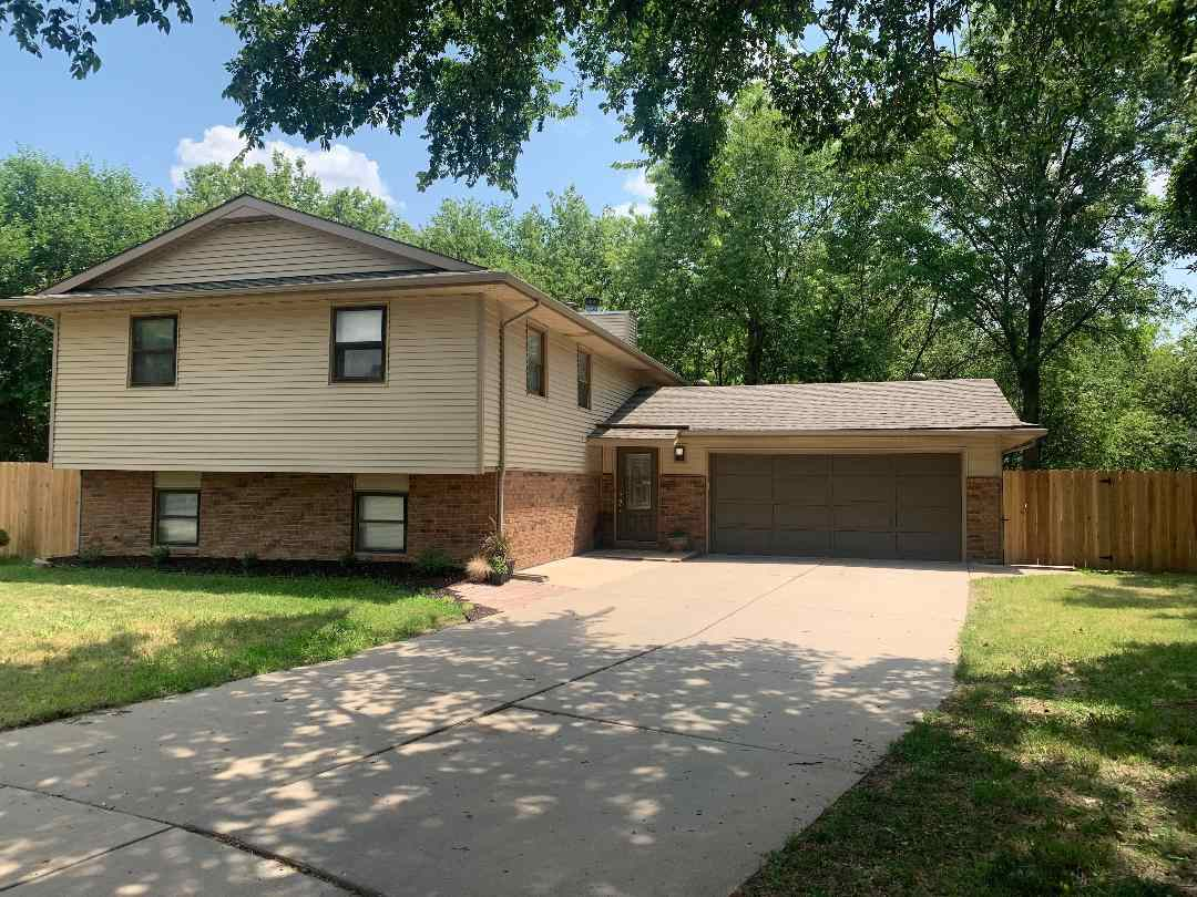 CHARMING 4 BED 3 BATH HOME THAT SITS ON A BEAUTIFUL WOODED LOT WITH  CHISHOLM CREEK IN YOUR VERY OWN