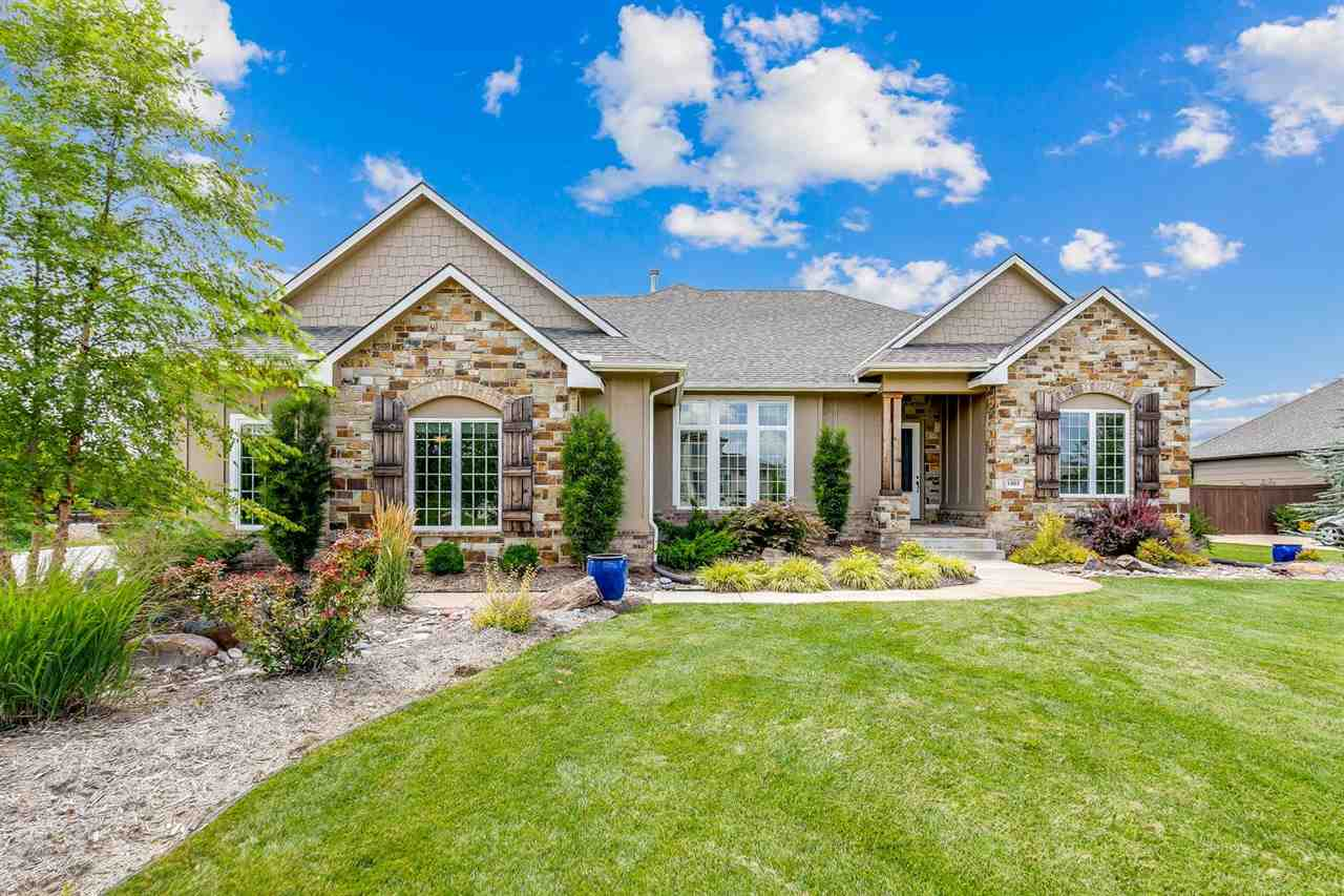 This beautiful home sits on an expansive 2 acre lot in the highly sought after Garden Walk Estates.