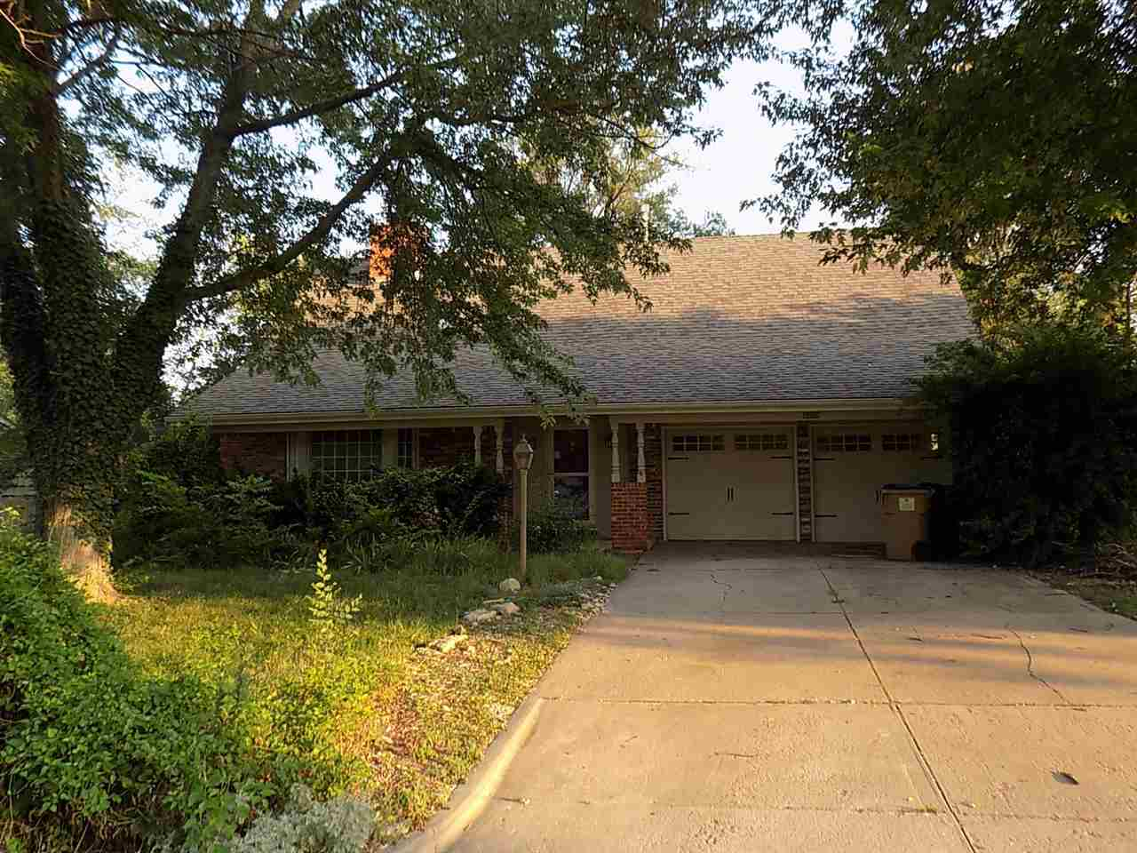 """Great home in Bel Aire for sale.  Nice vaulted ceilings with fireplace.   Home """"selling as is""""."""