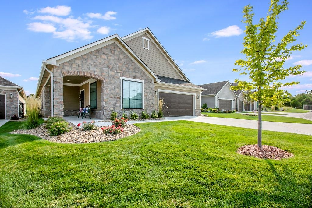 Fantastic Verona Plan that backs to a huge berm with total privacy in the back yard! The home has a