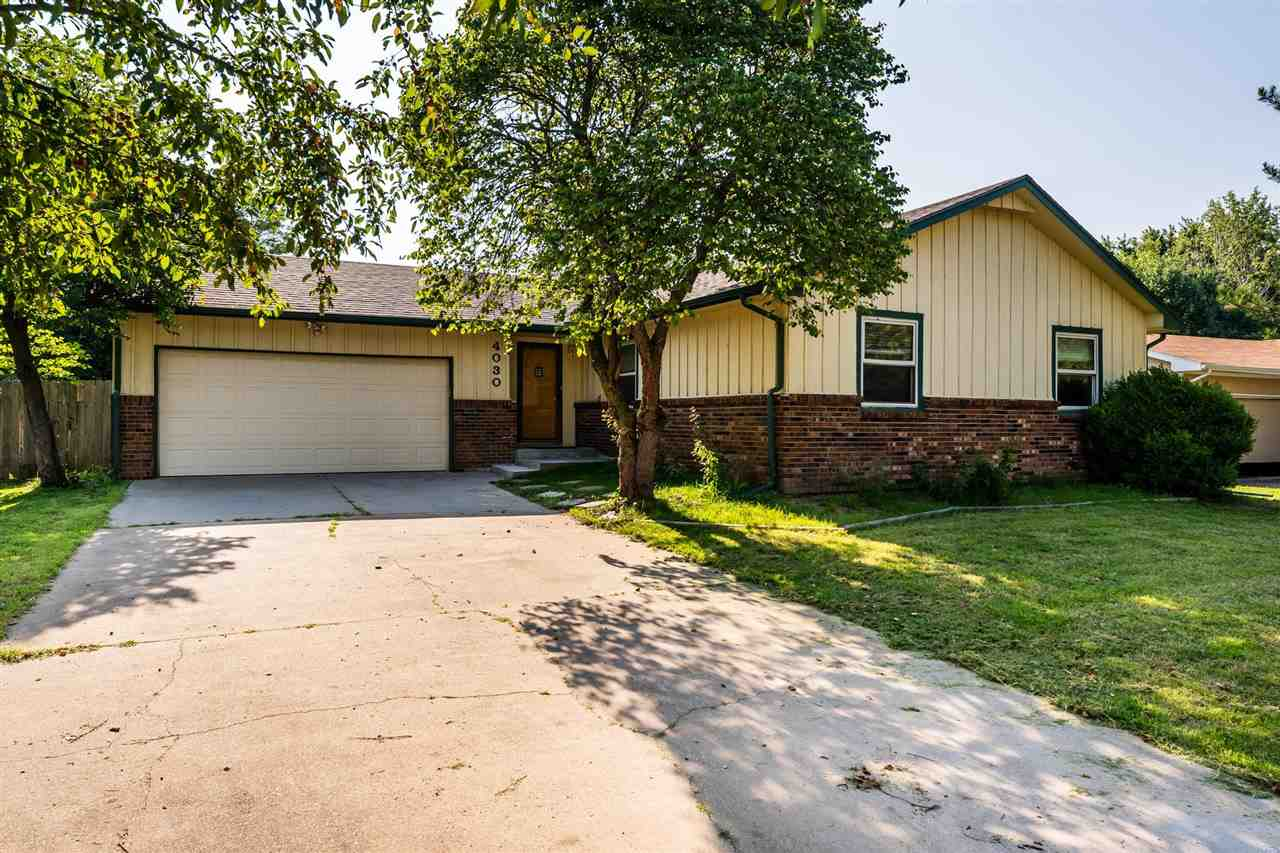Welcome Home!  Warm and inviting ranch complete with a great floor plan for easy entertaining, lovel