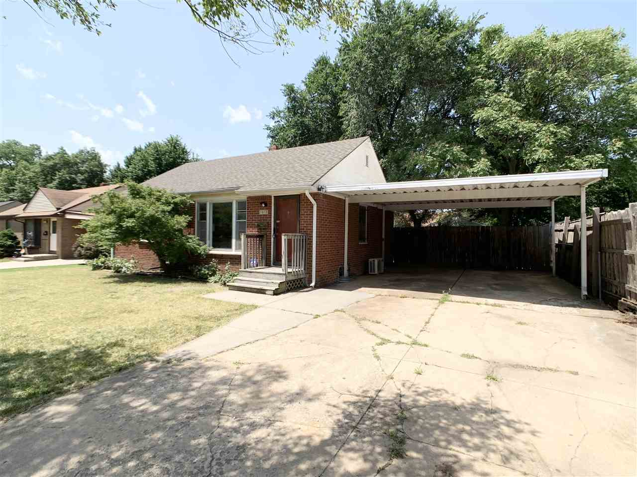 This all brick ranch is located in a quiet, southeast Wichita neighborhood. The exterior features a