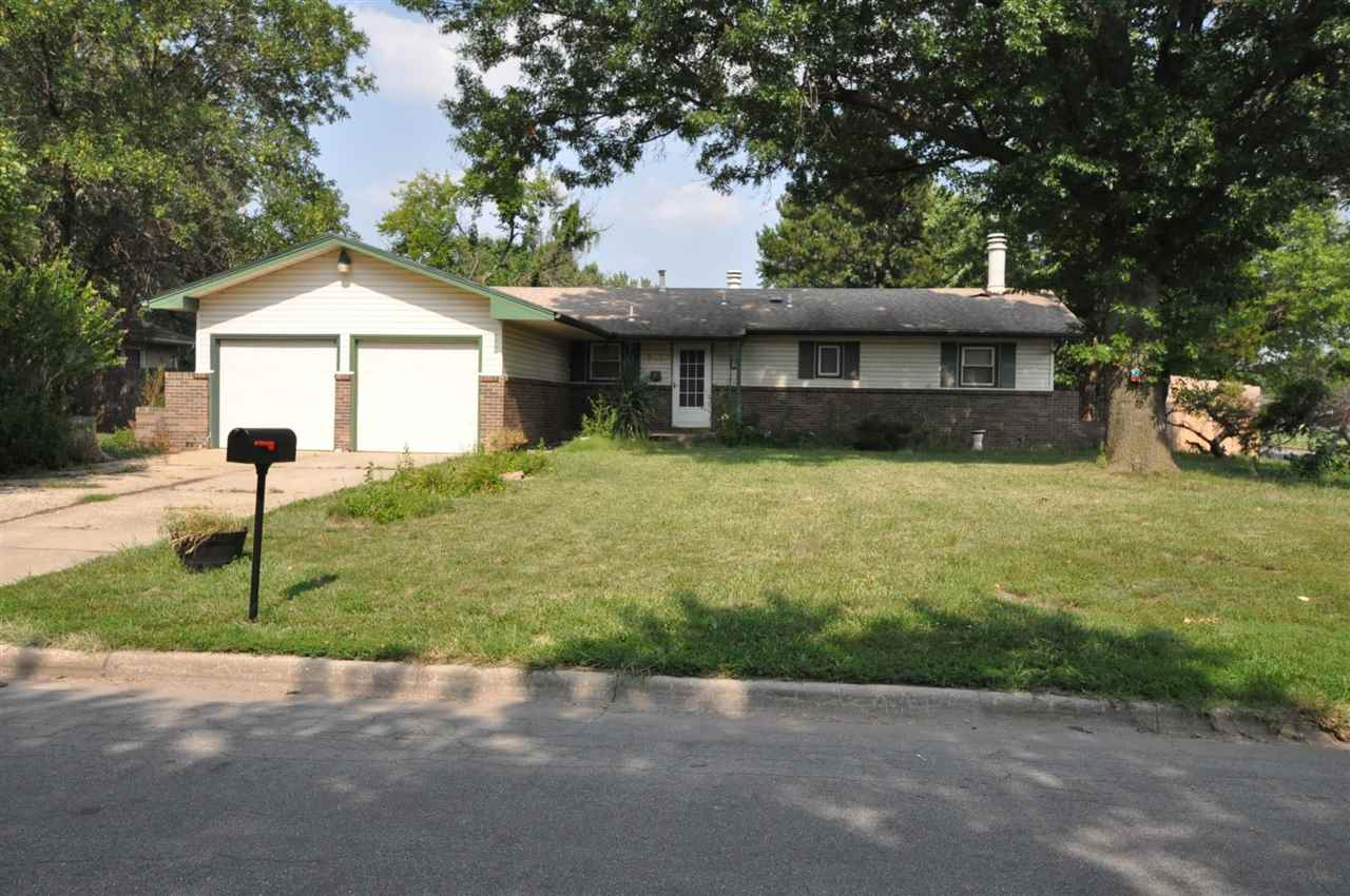 Innovative, charm and character describes this corner lot home in west Wichita! Former 3 bedroom, 1