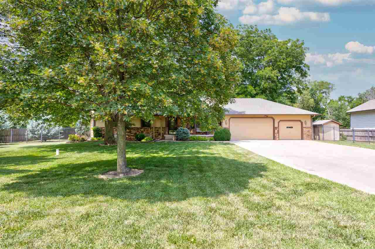 Beautiful Custom Built Home on a 1 Acre Treed, Creek Lot in Derby!  In- Ground Pool, a Fire pit and Lush Landscaping!  4 bedrooms and 4 bathrooms.  Full Finished Basement with Wet Bar and a Pool Table, Bonus Rec Room and Office!