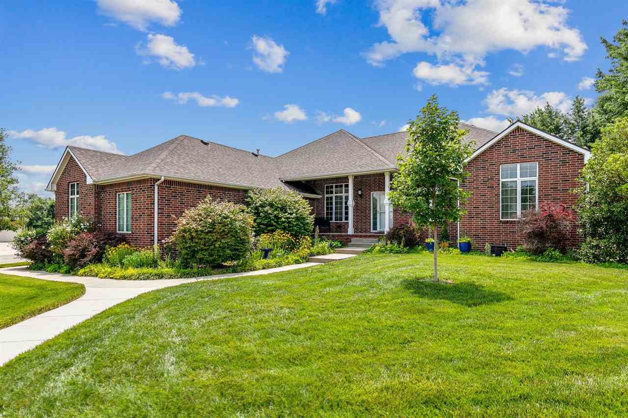 THIS HOUSE HAS IT ALL. SO MUCH CURB APPEAL - BRICK FRONTED WITH A SIDE-LOAD GARAGE. YOU WILL NOTE TH