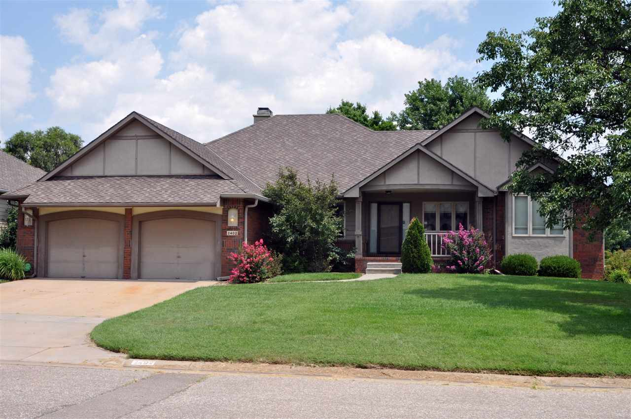 Golf course living in Reflection Ridge.  Former Model Home with so many extras. All Brick exterior f