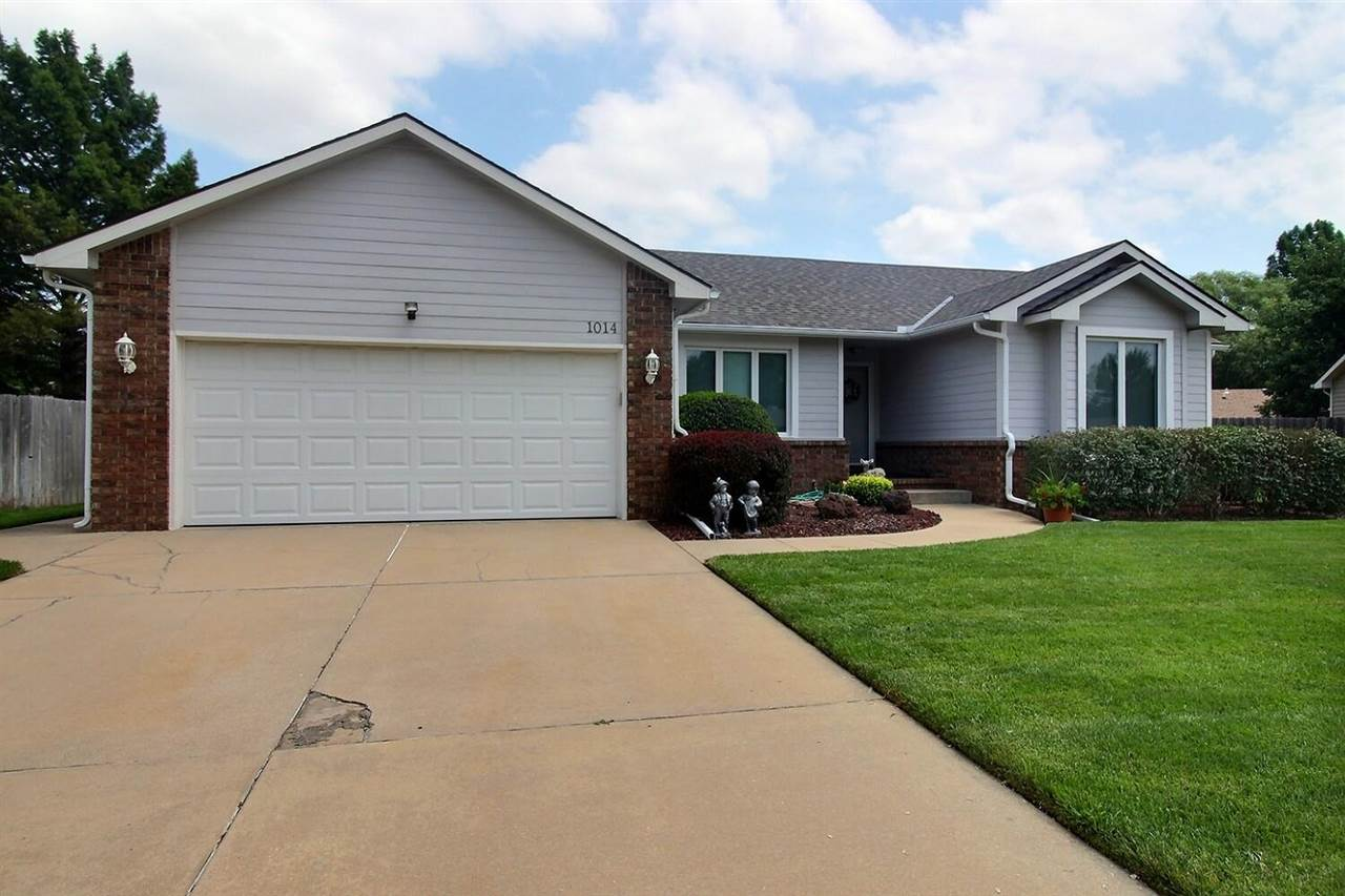 Amazing ranch home with 4 bedrooms, 3 baths and a ton of upgrades!  As you pass the stunningly green