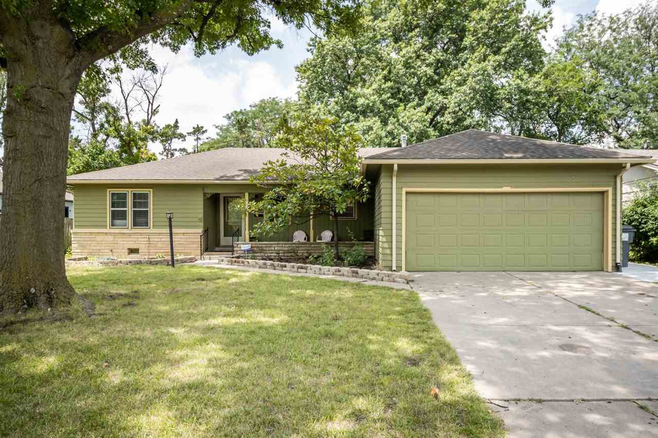Adorable East Side Ranch: Come see this gorgeous east side home, mid century built ins, cozy den wit