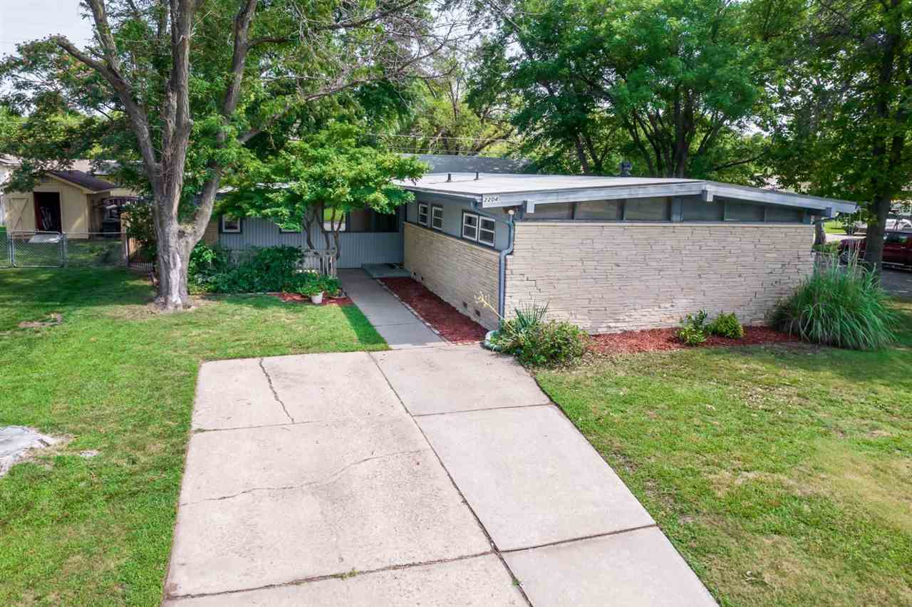 Hurry, this adorable Mid-century Modern sprawling ranch won't last!  1764 sq ft of main floor living