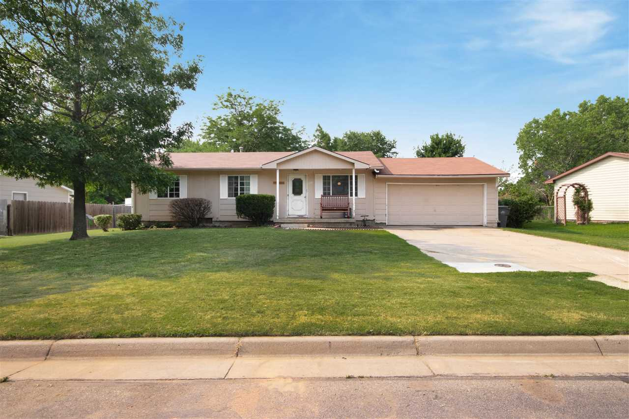 This ranch home has a large driveway to the two car attached garage and covered porch. There is room