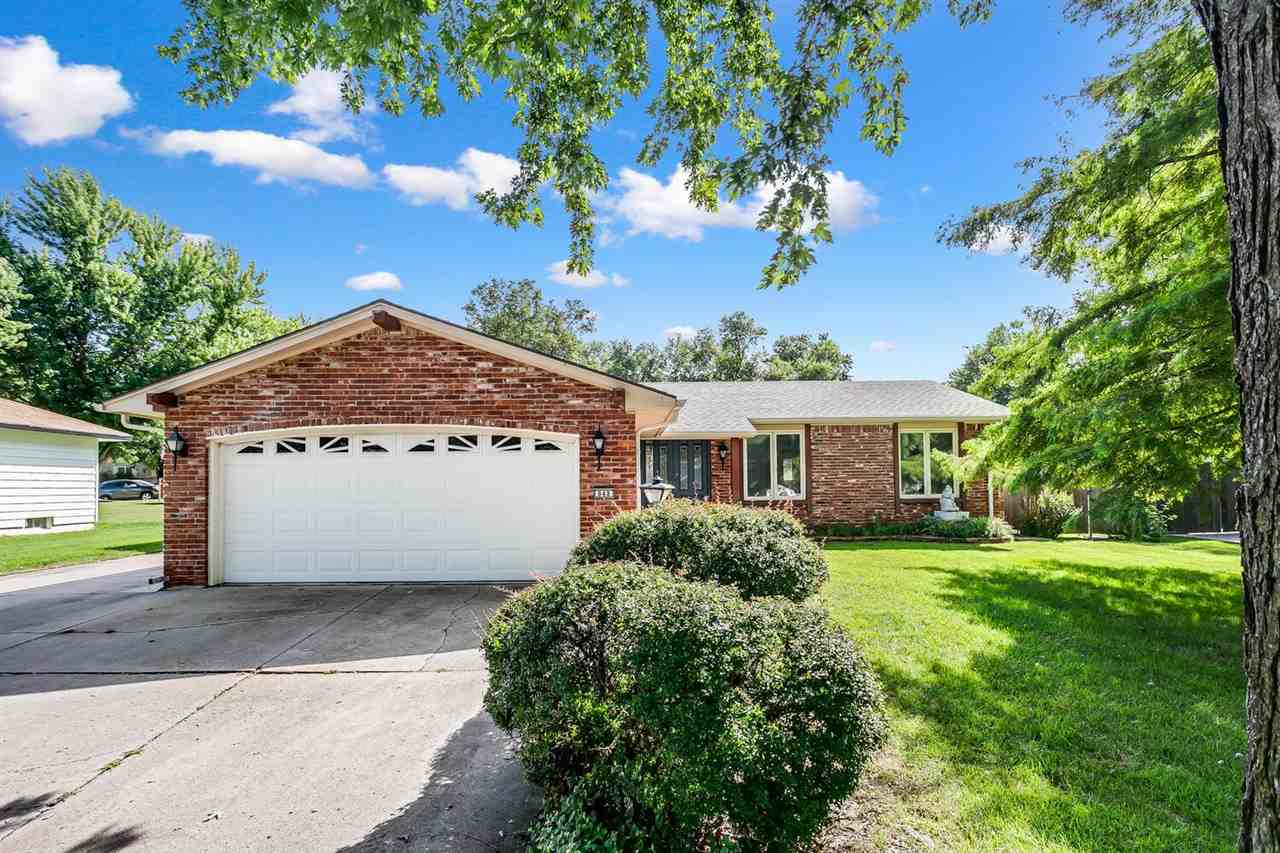 Gorgeous BRICK ranch that has been meticulously maintained. Premium STUNNING double entry door