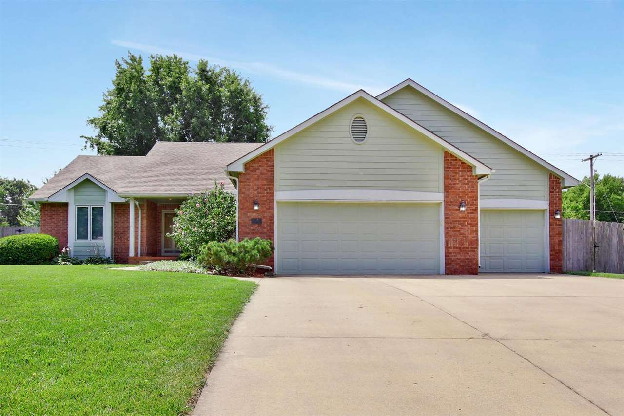 Beautiful 4 bedroom, 3 bath, 3 car garage home in Derby! Gorgeous hard wood floors on the main level