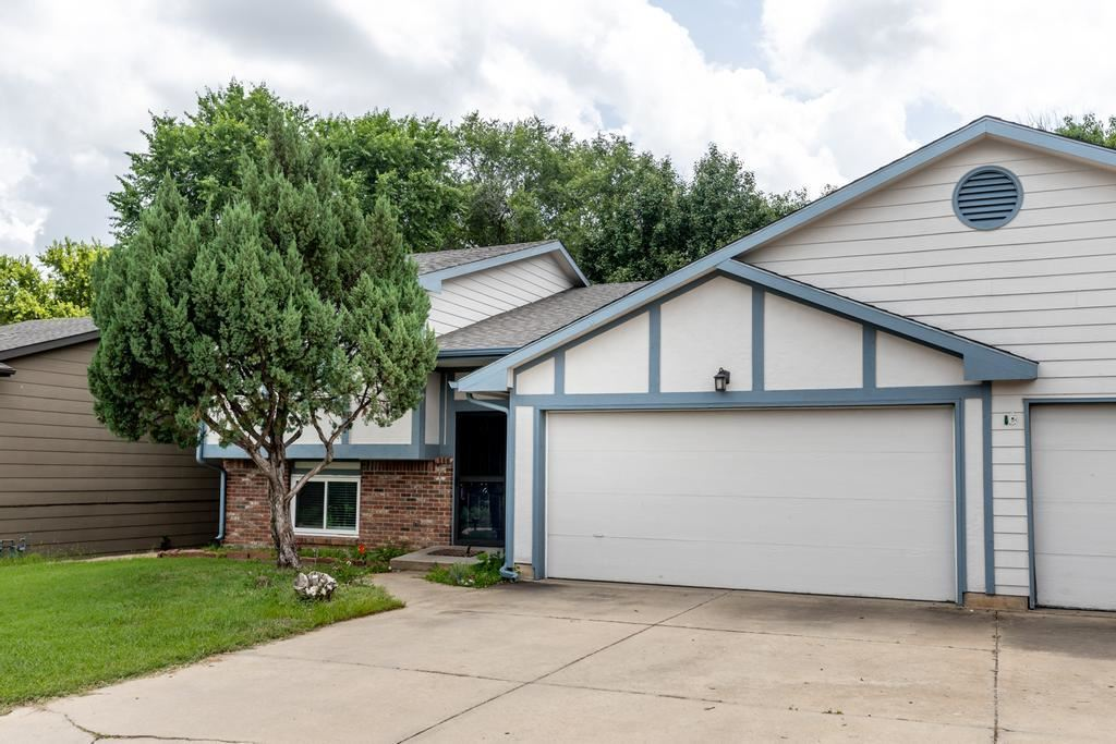 Welcome home to this lovely duplex close by shopping, schools, and more in Derby! You will be greete