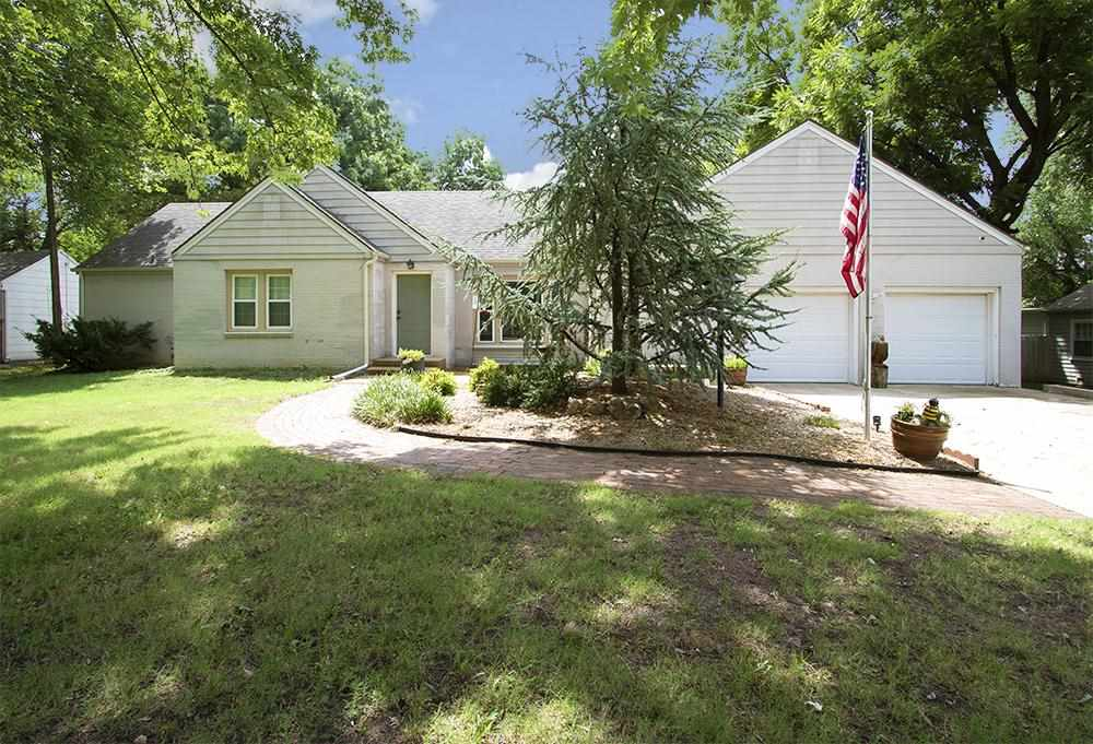 Ohhh---asis! Exceptional Elmwood addition! Nearly a half acre of seclusion on a super private street
