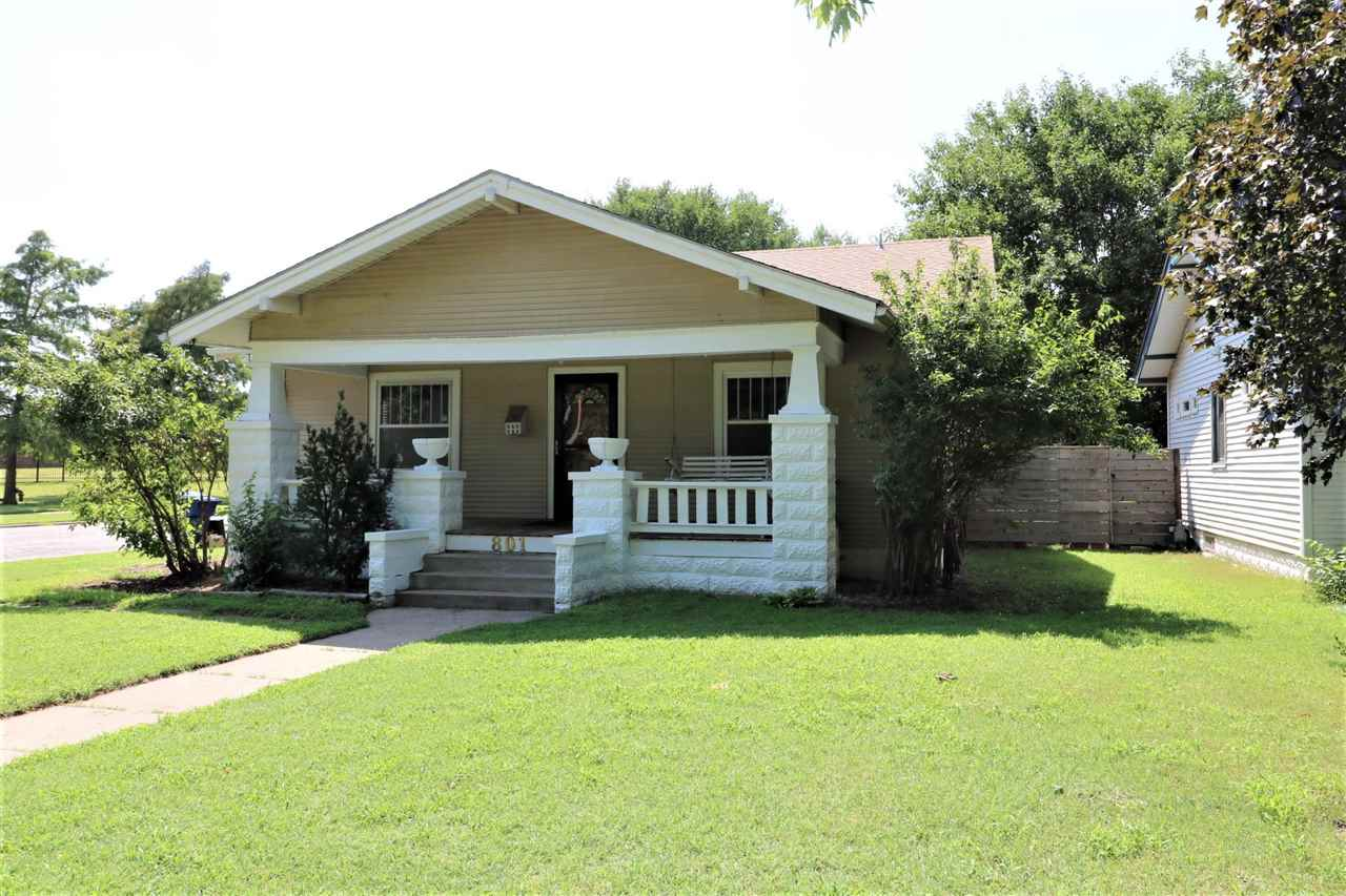 Riverside bungalow on a corner lot. 2 bedrooms, formal dining, finished basement with a family room,