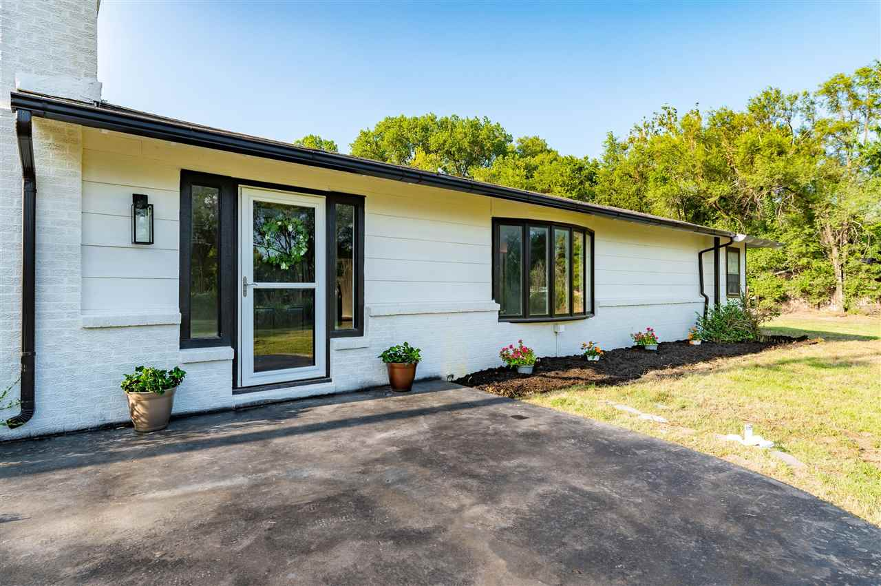 Welcome home to this complete remodel inside and out! Sitting on almost an acre, enjoy quiet country