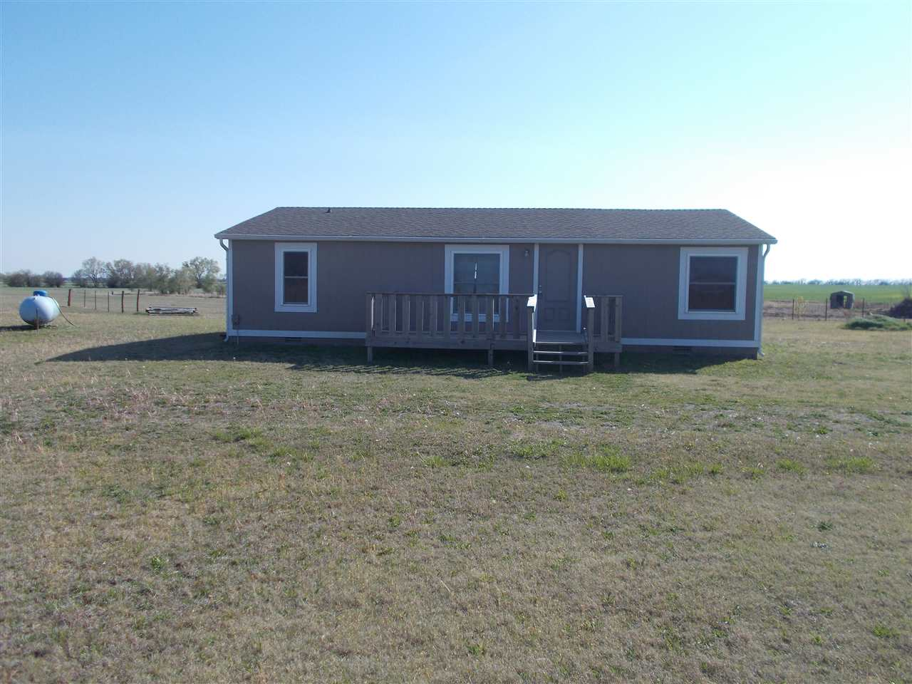 Wow nice updated modular home on over 5 acres.  This home allows horses on the property.  This home