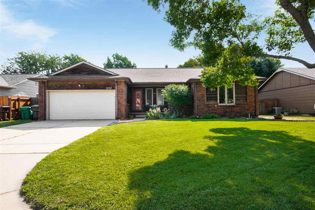 Come see this beautiful home in a quiet and well established west side neighborhood. Inviting covere