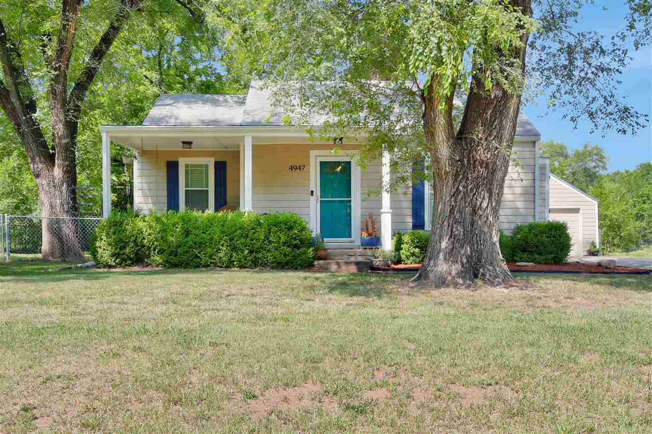 This charming, nestled home located in NW Wichita on 0.89 acres is sure to please! Beautiful well ta