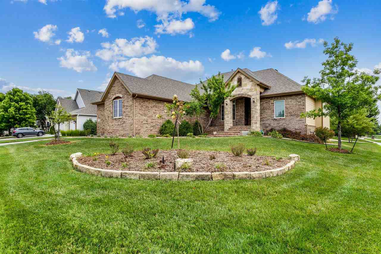 Don't miss this beautiful Nies built home in Hawthorne with gorgeous landscaping all around. There i