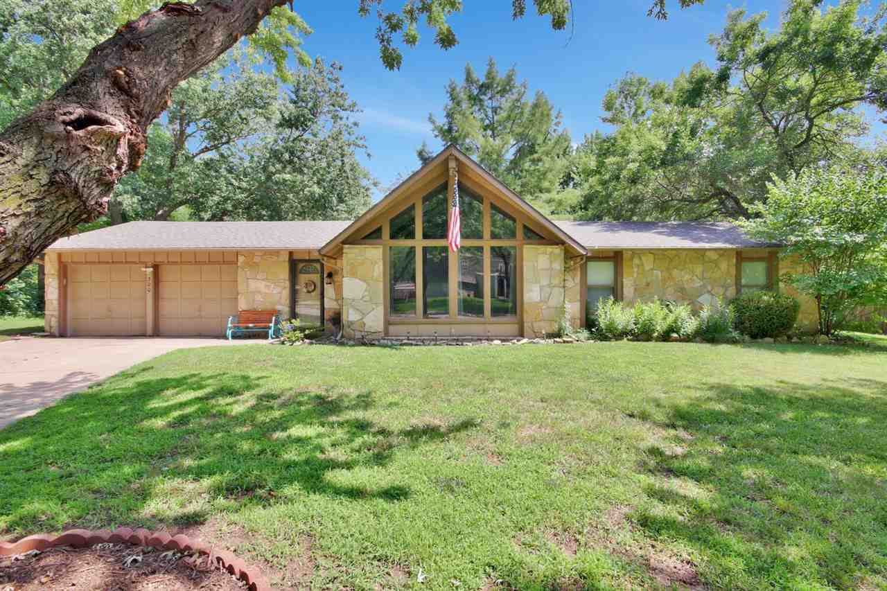 Immaculate zero entry stone ranch that sits on 1/2 acre lot in the heart of Derby.  Step inside to t