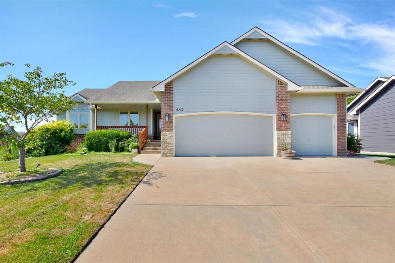 """JUST IN TIME FOR SUMMER FUN AND START OF A NEW SCHOOL YEAR!  Come see this lovely 5 bedroom home in popular Crescent Lakes neighborhood.  Tile entry greets you at the front door and leads you into the spacious living area of this open concept floor plan.  The living room boasts stone fireplace and picture windows with a gorgeous view of the backyard. The Dining area adjacent to the kitchen  has a wall of windows with access to the covered deck, perrfect for outdoor fun and entertaining.  The kitchen with its warm cabinetry, ample work space and breakfast bar make family meal preparations easy.  The main floor laundry is conveniently tucked between the kitchen and garage.  The Master Suite has a walk in closet, private bath with shower, jacuzzi bath and dual vanities.  Two additional bedrooms share the hall bath.   The view out lower level is complete with large family room, 2 more large bedrooms, bath and storage.  New interior paint plus newly painted experior make this home move in ready.  In addition to new paint, other numerous upgrades include all LED lighting throughout the home, """"Smart"""" Garage Doors, Epoxy garage floor,  Ring-Doorbell system, Commercial Sysco Wi-Fi CAT 6, Alarm System is active and can be transferred. Water Softner remains.  Crescent Lakes families enjoy 5 private stocked lakes, 2 community pools, clubhouse, playground, sidewalks that wind through the neighborhood and take children across the street to the highly rated Andover Central schools, K-12.  There is also a city park which hosts live concerts during the summer and fall.  Andover is also home to the newest and largest YMCA in the area complete with a waterpark."""