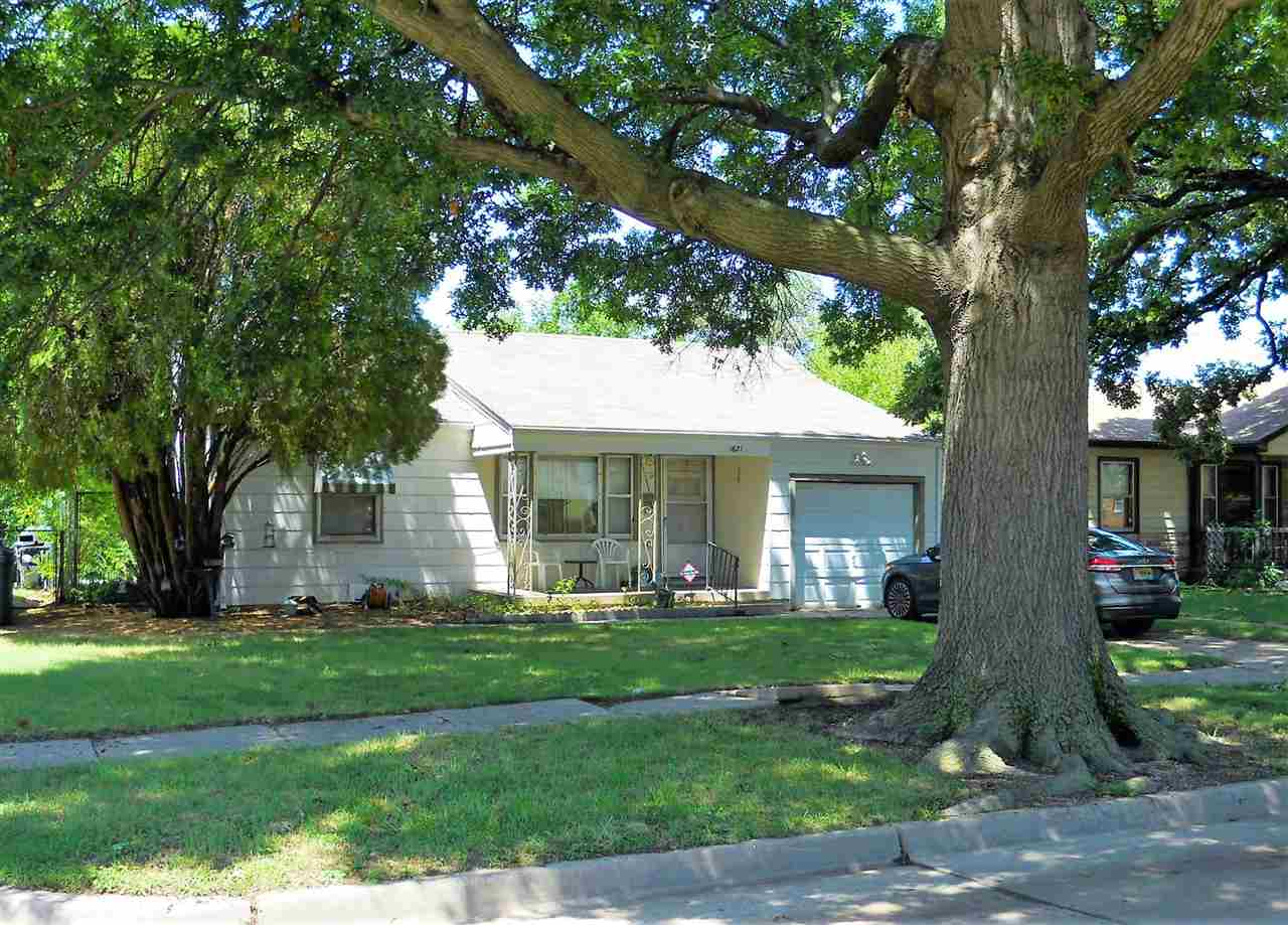 Charming 2 bedroom, 1 bath, 1 garage attached home. All new carpet throughout plus new laminate in K