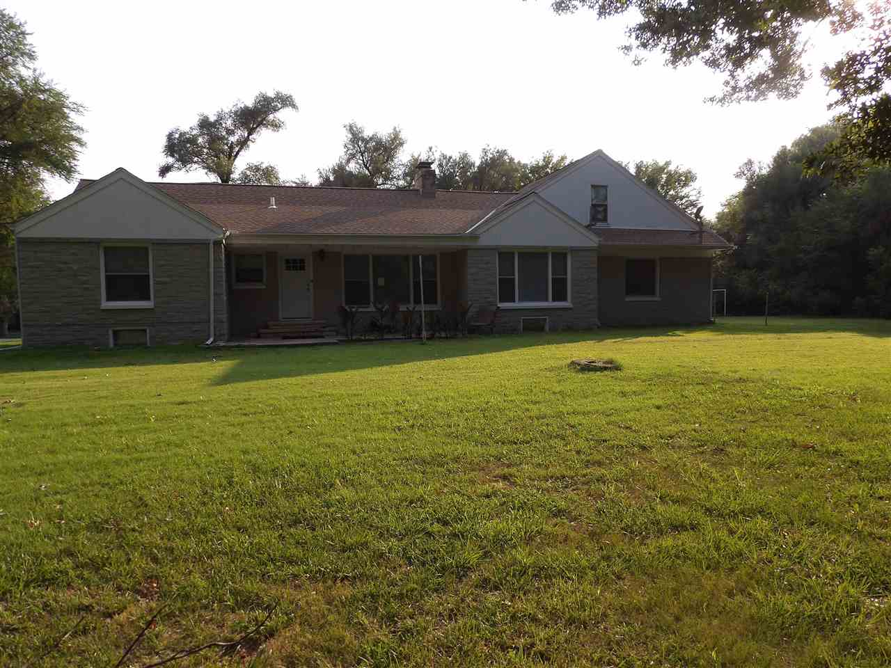 Come check out this spacious Elmwood Addition Home! This home is located on a corner lot over 1/2 Ac