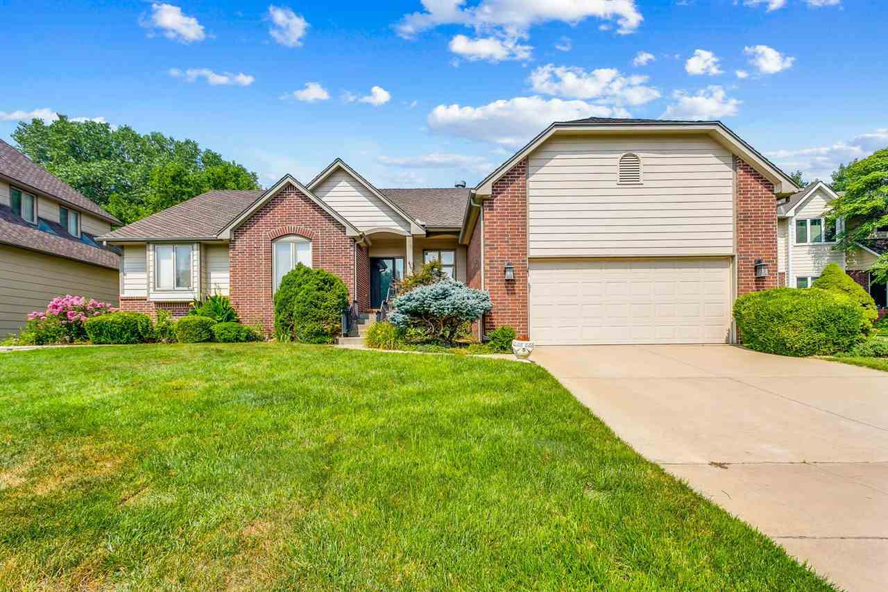 This stunning four bedroom home is located in the heart of west Wichita in a beautiful cul-de-sac an