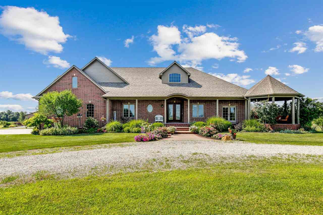 5 Bed/4.5 Bath custom built home on 30+ Acres just NW of Wichita on paved frontage!  Mature and mani