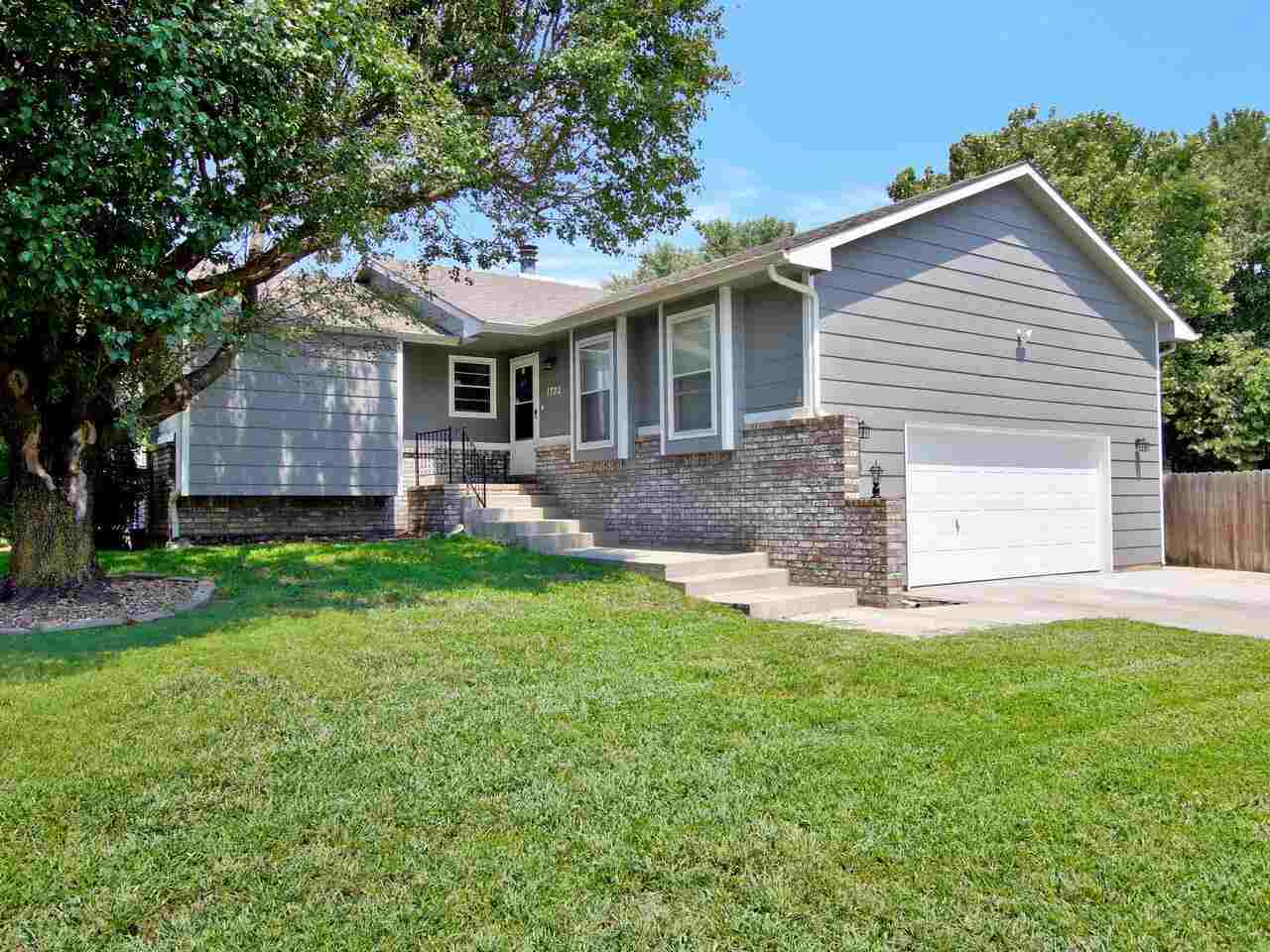 Location! Location! Location! Newly remodeled 4 bedroom 3 bathroom home on a corner lot with a walk