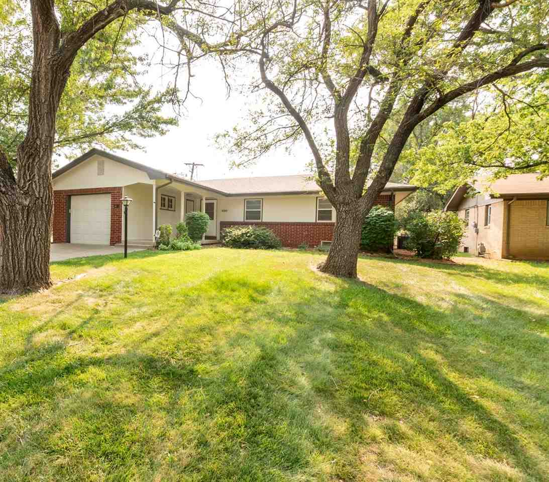 Brick home sitting on corner lot with fenced backyard. This home has had a total makeover and is mov