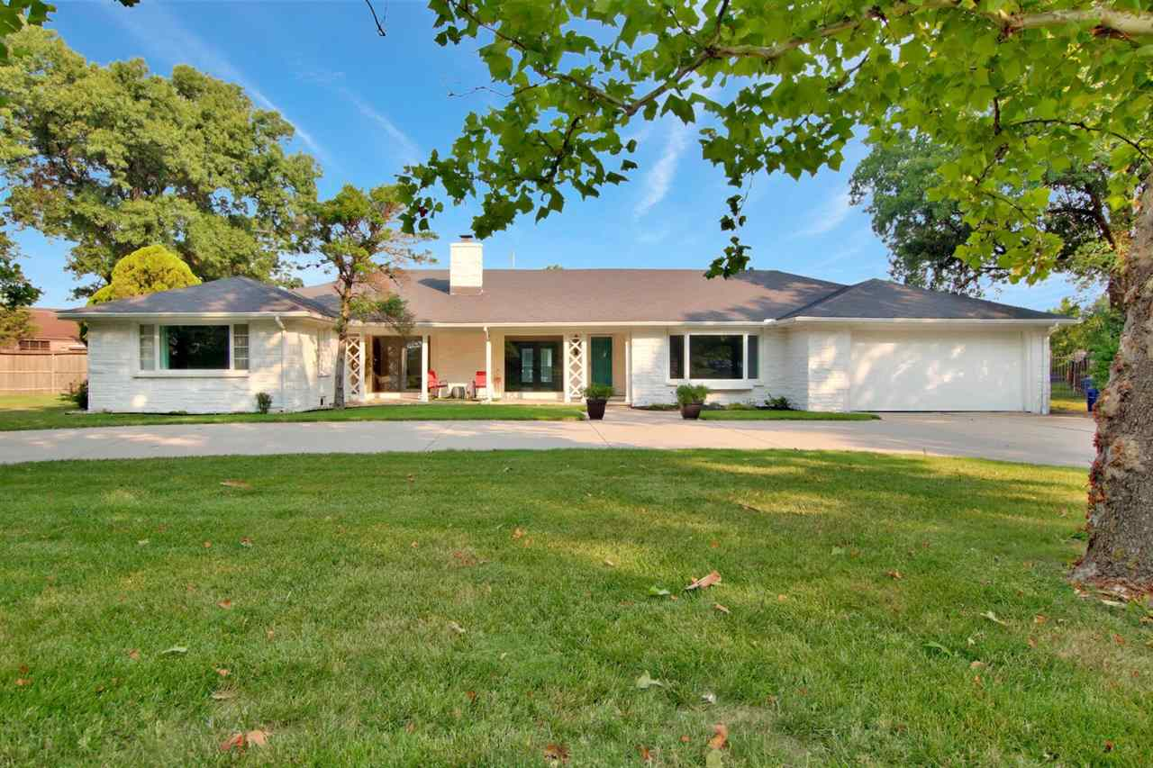 ENJOY EASTBOROUGH POND & PARK FROM YOUR FRONT PORCH!! This spacious ranch home is located on an .85